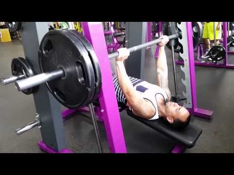 how much does a bench bar weigh at planet fitness how